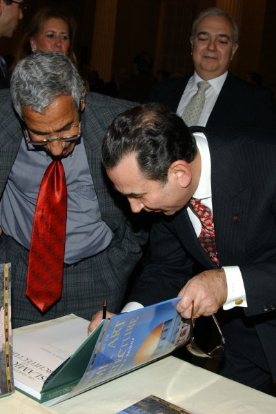 Signing the book - Timeline History of Islamic art and Architecture