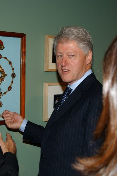 President Bill Clinton during a private view of the exhibition, Heaven on Earth at the Hermitage Rooms, Somerset House, London, 12th July 2004.