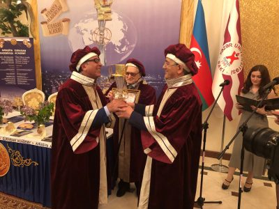 Professor Khalili received the Eurasian Legend Award from Professor Hamlet Isakhanli, Founding Member of the Eurasian Academy